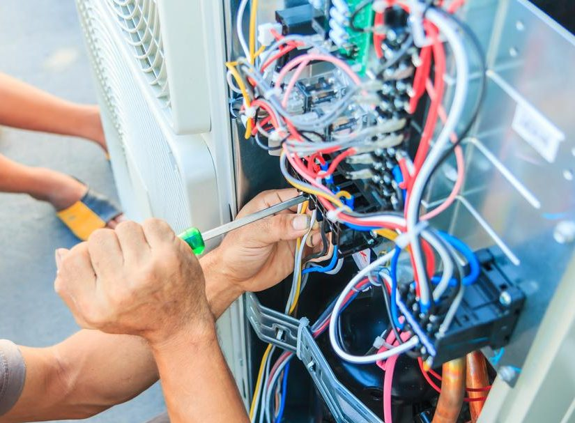 Air conditioner installation service being performed