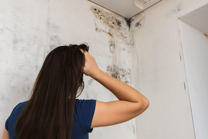 Mold growing in women's ceiling