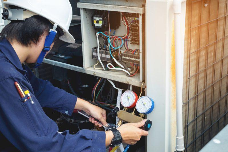 HVAC technician performing an AC Repair service