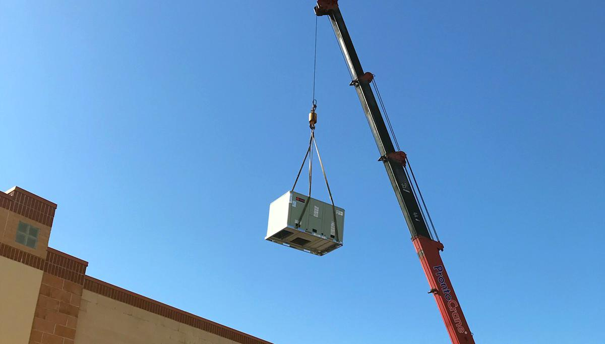 Commercial ac installation by crane