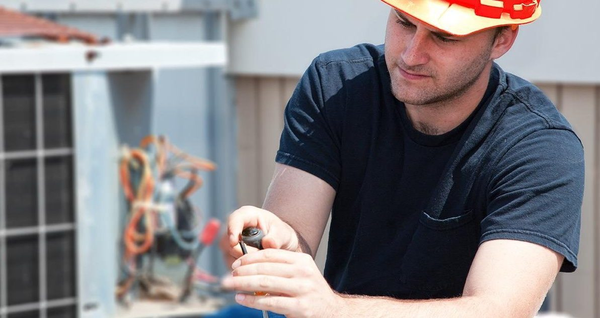 AC Repair technician working on an ac unit